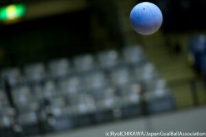 A goalball flies through the air