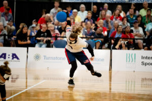 The USA's Eliana Mason winds up for a shot watched by spectators