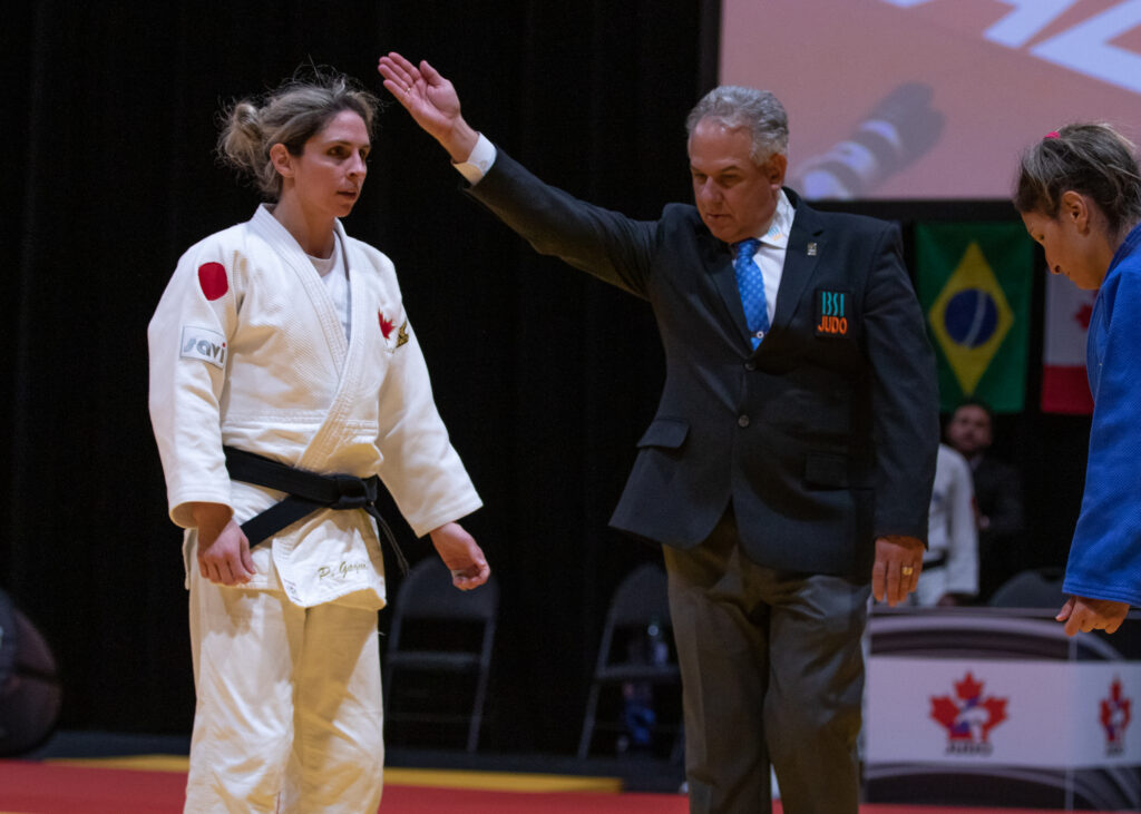 Priscilla Gagne is awarded the win by the referee as she stands opposite her opponent