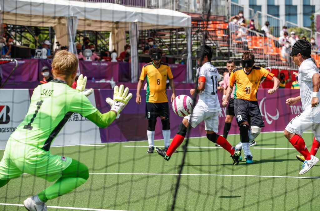 Brazil fire a shot towards the blind football goal in a match against Japan as the goalkeeper moves to make a save