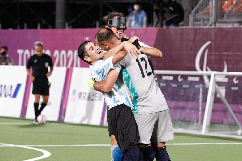 Players from Argentina celebrate their place in the final at Tokyo 2020 by hugging