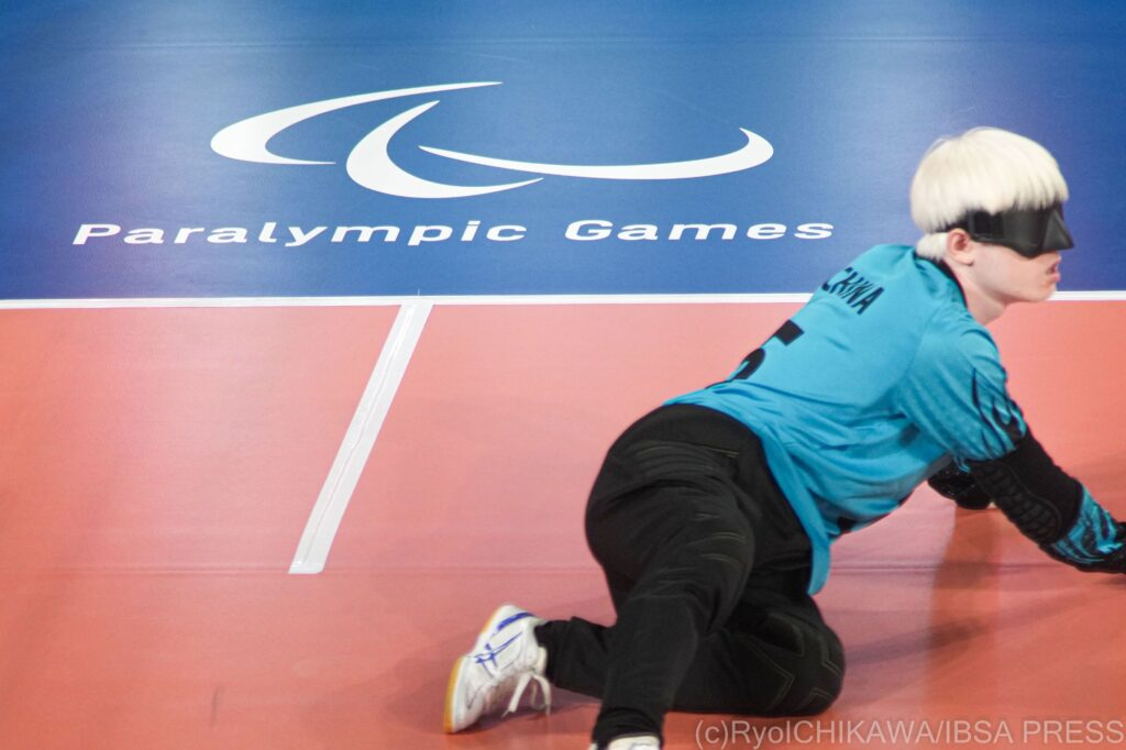 Hu Mingyao of China stretches out on court ready to block a shot